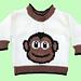 Baby sweater with monkey motif pattern