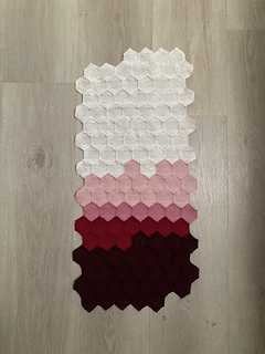 Data from January through April. Small hexagons arranged in 18 rows of 7. Top rows are white, then colors progress through two shades of pink, red, and bottom quarter is dark red.