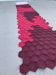 Close up of the red and dark red hexagons sewn together in the latter half of the visualization.