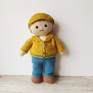 Joe doll, wearing his smart yellow jacket and cap.