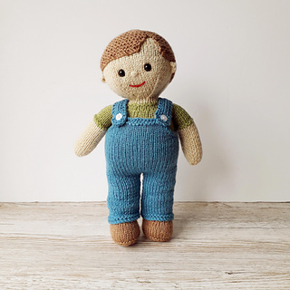 Billy, ready for fun, in his blue dungarees