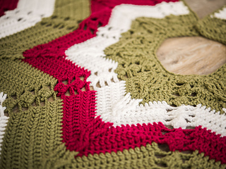 Classic Cable Star Christmas Tree Skirt close up made with Sprightly Acrylic Yarn