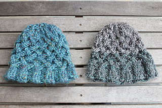 Hat on left using super bulky yarn and hat on right uses bulky yarn