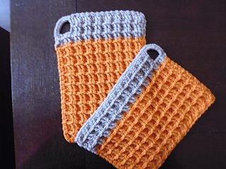 pair of waffled potholders with vertical and horizontal bar