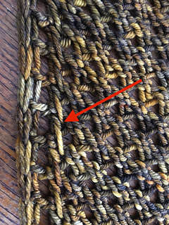When alternating skeins, changing color on the stitch before the three edge stitches on a PXST row will help  keep the edge tidy. (wrong side pictured)