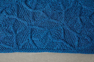 This is a side half-hexagon, knitted on when the blanket has been assembled.