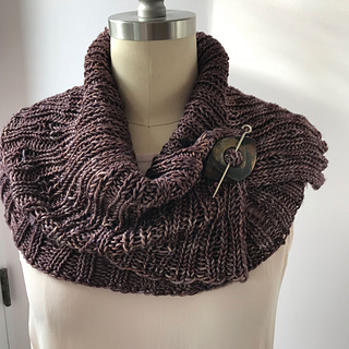 Worsted Combined in It Could Be Worsted, closed with a shawl pin.