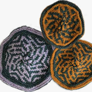 A trio of Crowns!  The pattern is the same, but the number of stitches creates a unique motif for each size.