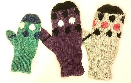 Three Mari Mitts, one in child's size large in green, blue and white, the middle mitten is a women's medium in purple, black and white and the mitt on the right is a women's medium in handspun: gray wool, red wool, and naturally black alpaca