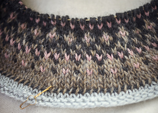 Beg. of yoke with some rows of provisional cast-on (light grey yarn). Note how the first row of main color sts are secured with a strand of black yarn; from where body & sleeves are knitted top down later.