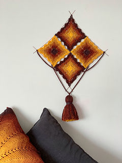 'Serving suggestion' mount on wires with a lucet cord and a tassel for a wall hanging.