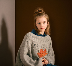 worn with about 76 cm positive ease, knitted with worsted wool yarn.