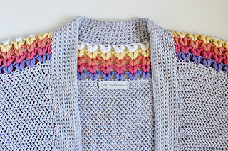 Collar of a grey Sundae Cardigan showing the accent puff stitches along the top.