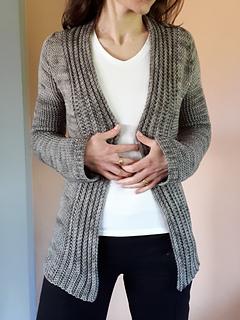 A tunic-length crocheted cardigan