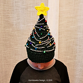 Crochet Christmas Tree Hat Pattern by Rhondda Mol of Oombawka Design Crochet. Free Pattern in multiple sizes. Have fun decorating these!