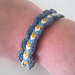 Friendship bracelet with crocheted edge pattern