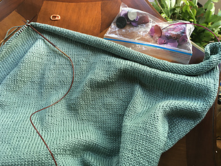 One set of stitches ( for the front) is placed on a spare cable.