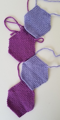 Instead of folding the hexagons first, you line them up as shown (here without stretch).