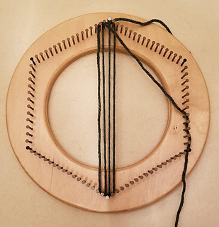 """For the hat band or friendship bracelet, start weaving as usual until you have four """"warp"""" strands. Then wrap around all nails 4 times to measure enough yarn for the """"weft""""."""
