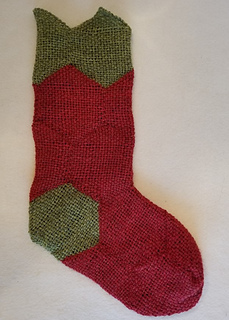 Turn the sock right side out. Weave in remaining tails. Block as desired. Add a hanger and/or embellish the top trim.