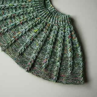 Notice how the dark green mohair highlights the dip stitches because  contrasts with the first color sock yarn used in the yoke. This contrast lends a beautiful depth and richness to the stitches while allowing the speckles to POP! Keep that in mind when stashbusting!