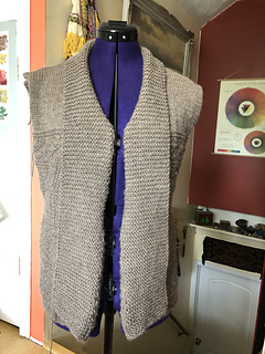 Please note that front shaping on this cardigan has a strong fold tendency, the folded front openings look like this.