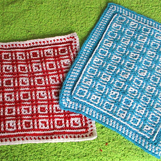Crocheted by Miloslava; red uses mosaic technique, blue uses interlocking. She also added a fancy border.
