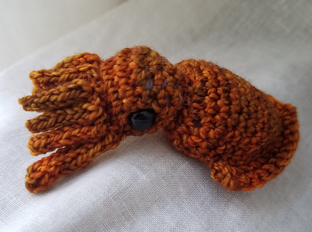 A small brown crochet cuttlefish