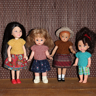 The tees fit well on the Kelly dolls.  They are a bit snug at the hem on the center two.  If I knit tees just for them, I will add another set of increases.