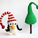 New Year Penguin in hat with Christmas tree pattern