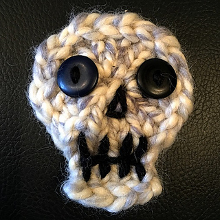 """12-peg Skully using LB Wool-Ease Thick & Quick with button eyes. This one was 3"""", an inch larger than all the others."""