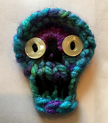 12-peg Skully using Loops & Threads Charisma in Passion colorway with button eyes.