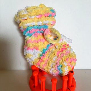 "3-6 month size 4"" bootie using the 3/4"" gauge Flower Loom with Bernat Baby Blanket yarn."