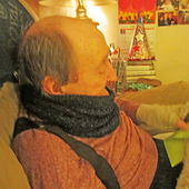 Royal on his 90th birthday (2/26/20) wearing cowl and fingerless mitts I knit for him.