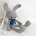 Long-legged bunny in a vest pattern