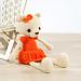 Long-legged teddy bear in a dress pattern