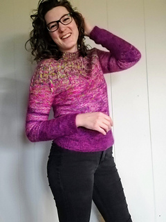 """Size 38.5"""" shown on a 36"""" model. Knit with a variety of Stash yarn, *see knitter's project page for info"""
