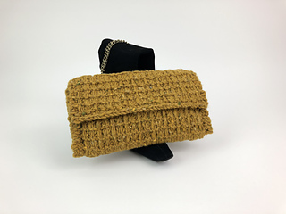 The perfect clutch for town or country when you want a bit of textured elegance to add some flair to your standard winter wardrobe