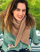 Model wearing On a Wing scarf in pink and green