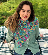 Model wearing One Rainbow scarf in variegated yarn