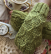 Buddy Bear Mitts have soft smocked gathers on the top bordered by ribbed cuffs at the wrists and fingers.