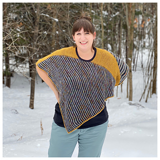 """Model is 5'-7"""" with 46"""" bust wearing Size 1, which creates a more cropped fit. This styling has the contrast stripe along the arms. This side shows the narrower stripes."""