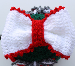 Bow at the top of the teapot cosy