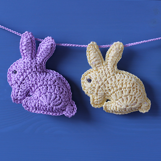 Bunny rabbit soft toys as bunting or stroller mobile