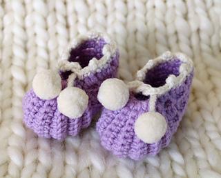 Baby booties with pom pom trim