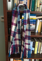The finished scarf is 66 inches long including the fringe, and 9 inches wide. The ppi matches the sett, so I ended up with the balanced weave I was hoping for.