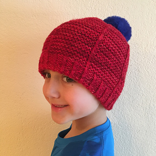 another satisfied customer modeling a double thick brim with a pompom!