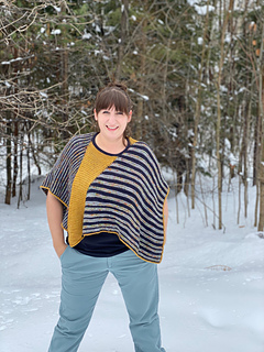 """Model is 5'-7"""" with 46"""" bust wearing Size 1, which creates a more cropped fit. This styling shows the piece squarely on the shoulders with the stripes in the horizontal direction. This styling creates a boxier fit and shorter """"sleeves""""."""