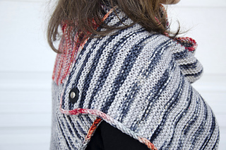 This shows the back shoulder of the styling with the poncho worn as a dress. This is the pedestal-style removable button.